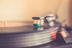 Playing retro music: Professional turn able audio vinyl record music player. Close up picture of a record player, playing a record vinyl music retro vintage royalty free stock photo