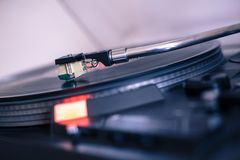 Playing retro music: Professional turn able audio vinyl record music player. Close up picture of a record player, playing a record vinyl music retro vintage stock image