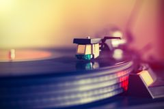 Playing retro music: Professional turn able audio vinyl record music player. Sunbeam. Close up picture of a record player, playing a record. Sunbeam vinyl music royalty free stock photography
