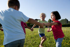 Playing ring-around-the-rosy. Small group of children playing ring-around-the-rosy Stock Photos