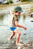 Playing in river water. Boy playing in a mountain river water during summer Royalty Free Stock Image