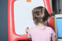 Playing room for chidren. little girl have fun Stock Photos