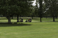 Playing a Round of Golf. Allaire Golf Course, Allaire NJ, USA -- August 2, 2016 Golfers out playing a round in late morning. Editorial Use Only Royalty Free Stock Photo