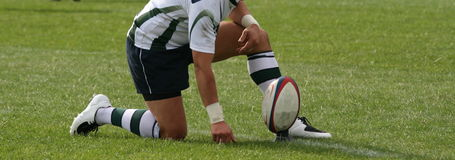 Playing rugby. Men playing the game of rugby union Royalty Free Stock Photography