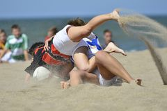 Playing rugby at the beach. Team sport royalty free stock photography