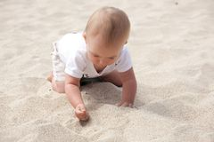 Playing on sand Stock Photos