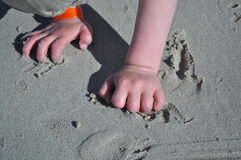 Playing in the sand. Hands of a child playing in the sand Royalty Free Stock Photo