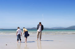 Playing with sand. Sardinia,two boys and their dad playing with wet sand Stock Photography