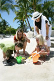 Playing in the sand. Two women and children playing in the sand on their vacation in Florida Royalty Free Stock Photo