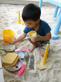 Playing with sand. Child playing sand on the playground Stock Images