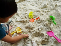 Playing with sand. Child playing sand on the playground Royalty Free Stock Image
