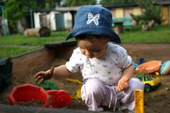 Playing in the sand pit Stock Images