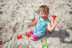 Playing with sand and plastic letters Royalty Free Stock Image