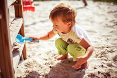 Playing with sand on playground Royalty Free Stock Photo