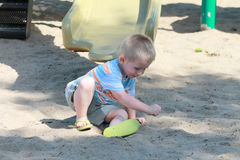 Playing in the sand Royalty Free Stock Image