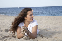 Playing in the Sand. Woman enjoying playing with sand Stock Photos