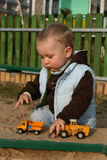 Playing in the sandpit Stock Images