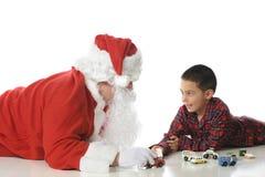 Playing with Santa stock photos