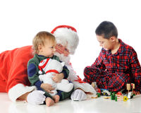 Playing with Santa stock photo