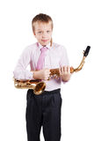 Playing the sax. Young boy playing the sax Royalty Free Stock Image