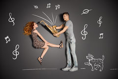 Playing the sax for him. Happy valentines love story concept of a romantic couple against chalk drawings background. Female playing the sax for her boyfriend royalty free stock images