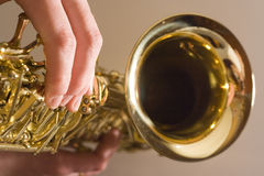 Playing Saxophone. Lady playing the sax Royalty Free Stock Photo