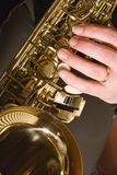 Playing the Saxophone. Close-up of a person playing the saxophone Royalty Free Stock Photo