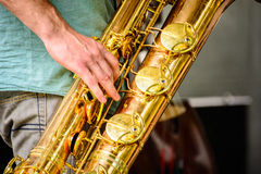 Playing the saxophone. Detail of player on the saxophone Royalty Free Stock Images