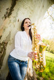Playing saxophone in nature Royalty Free Stock Photo