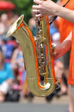 Playing Saxophone in Parade Stock Image