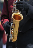 Playing Saxophone in Parade Royalty Free Stock Images