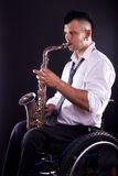 Playing saxophone Stock Photography