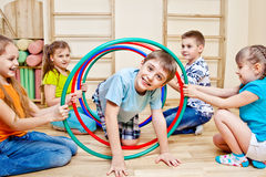 Playing in school gym stock photography