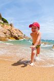 Playing on a sea coast Royalty Free Stock Image