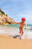 Playing on a sea coast Stock Photography
