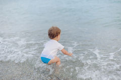 Playing in Sea Stock Photography