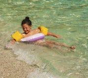 Playing in sea waves. Plaka beach, Pelion, Greece Royalty Free Stock Image