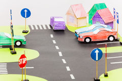 Playing set with road sings, crossings and cars. Playing set with road sings, crossings and colored paper cars on parking Stock Photography
