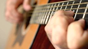 Playing A Six String Acoustci Guitar stock video