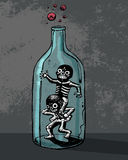 Playing skeletons inside a bottle Stock Images