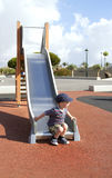 Playing on a slide Royalty Free Stock Photo