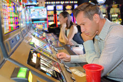 Playing on slot machines Stock Photos