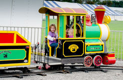 Playing in a small train at an outdoor festival Stock Photography