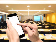 Playing smartphone in conference room Stock Images