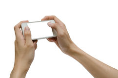 Playing smartphone isolated. Hands holding a white smartphone Royalty Free Stock Image