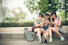 Playing on smartphones Stock Images