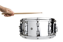 Playing Snare Drum. Hand hitting on a big metal snare drum isolated on white Royalty Free Stock Photography