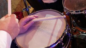 Playing on the snare drum stock footage