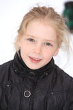 Playing in the snow 2. Pre teen in a black coat playing in the snow Stock Photography