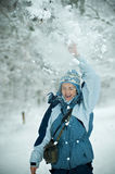 Playing with Snow. A woman playing in the snow Royalty Free Stock Image